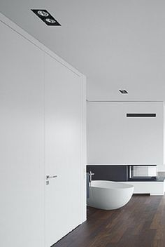 Clean lines, bathroom inside the Villa Griebnitzee by Axthelm & Rolvien Architects