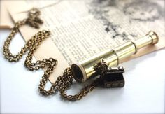 A Pirate's Treasure Chest - A Vintage Brass  SpyGlass, Telescope Necklace.  Pirates of the Caribbean Movie Inspired Necklace.  Ships, Old World, Marines Ocean. $27.50, via Etsy.