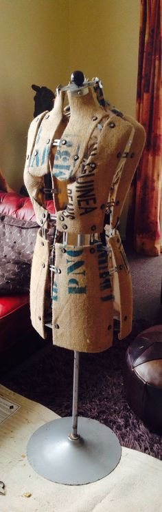 Upcycled dress form recovered in burlap.