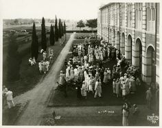 Garden Party after 11th Rice Institute commencement, outside the Administration Building, 1926