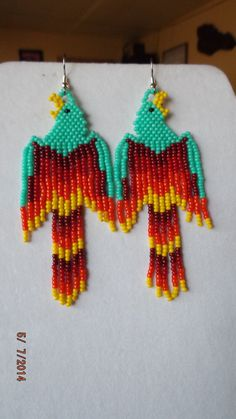 These Beautiful Native Beaded Red Phoenix Earrings are Custom made by Elaine. With Red, Orange, Yellow Sead Beads. If you like these but would