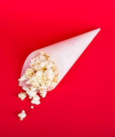 Dish up fries, popcorn, and other snacks in grease-resistant parchment cones (seal them with tape).