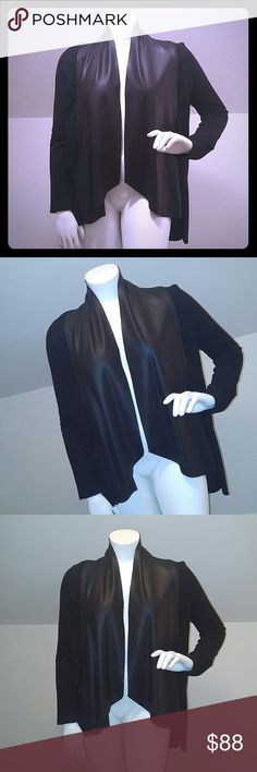 Karen Kane Faux Leather Blazer A versatile faux front leather open blazer,highlow style,stretchy arms and back...💯TIMELESS & CLASSIC! You can lay the faux leather flat & raise the collar like I styled the mannequin for a dramatic look or fold as well like the Nordstrom stock photo of a real model wearing the front folded Mannequin is a 🔴LARGE/XL🔴  -89% rayon -6% nylon -5% spandex -worn gently once with love but not my style so it's been in my walk in closet hanging on a wooden garment…