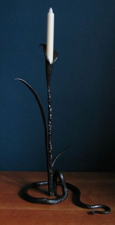 Water Lilly Candle holder, made by (artist & blacksmith) Adrian Stapleton, hand forged in Notinghamshire at Trinity Forge