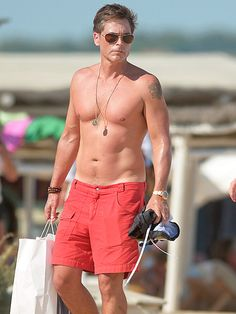Rob Lowe makes 50 look FAB! The hot dad, in classic aviator sunnies, flaunted his toned physique in France!