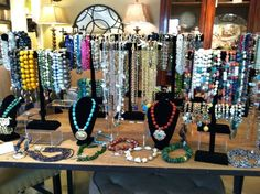 Table full of handcrafted one-of-a-kind couture jewelry...  www.gayharrison.com
