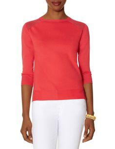 Sheer shoulder insets mix up this block of color with flirty contrast.