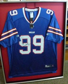 Autographed Buffalo Bills jersey in a display case. #buffalosports #football