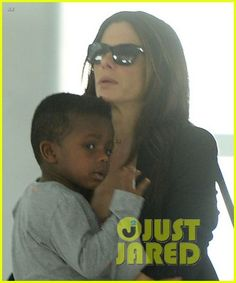 Sandra Bullock departs a flight out of JFK Airport with her son Louis on October 4, 2013