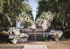 vineyard wedding ceremony with all white flowers