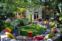 eclectic landscape by Harold Leidner Landscape Architects -  cushions, concrete seating, artificial grass