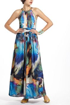 I can only think of margaritas and sangria when I see this dress. Worn in someplace warm on a patio drink. It's definitely an ode to long 1970s maxi dresses.