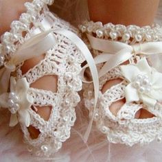 Crochet baby shoes  $35.00 Wow! A REALLY young flower girl or about the youngest child-bride's feet I've ever seen. Aren't they exquisite?