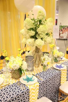 Navy and yellow tablescape from Flowers By Holland | Bridal Extravaganza of Atlanta Bridal Show