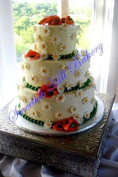 daisy and calla lily cake