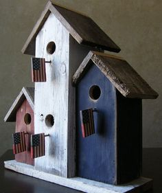 red, white, blue birdhouse... love how they used flags for the perch***Research for possible future project.