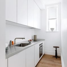 White Kitchen with Steel Worktop