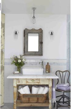 Repurposed Powder Room ~ beautiful table converted into a sink, love the industrial light, vintage cabinet and chair