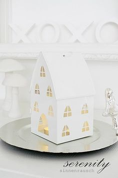 Don't let your DIY Candle House burn down! Use Candle Impressions flameless candles and create your own with thick paper. Has any one else noticed white candle houses are trending for the 2013 holidays?
