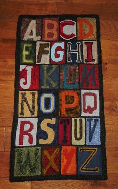 A large 19 1/2 by 37 inches tall ABC hooked rug. I just loved hooking this rug. My husband drew up the pattern for me. Hooked with hand dyed wools and off the bolt textured wools. I have listed it on Ebay.