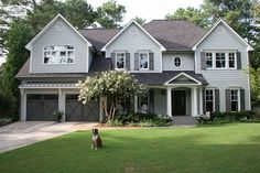 Click for a before and after - love the landscaping around the porch and paint colors!