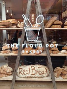 The Flour Pot Bakery and Cafe 40 Sydney Street, Brighton EnglandYou can find Bakery shops and more on our website. Bakery Cafe, Rustic Bakery, Flour Bakery, Bakery Store, Bakery Display, Bread Display, Bakery Branding, Bakery Logo, Logo Doce