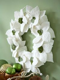 Felt is usually found in the kids' crafting section at the store, but there is nothing childish about this poinsettia wreath.  Gorgeous!  I always find great things on Better Homes and Garden's site.