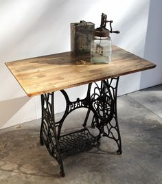 Vintage PFAFF 31 cast iron sewing table with reclaimed hardwood top. weatheredwarehouse.com