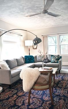 Awesome color combo....grey couch teal accents. I have a grey couch on order. Fingers crossed that I can pull it off as well.