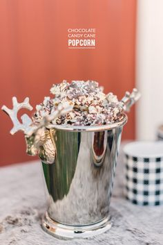 Chocolate Candy Cane Popcorn  Read more - http://www.stylemepretty.com/living/2013/12/13/chocolate-candy-cane-popcorn/