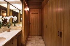 The only full privacy that exists in the main house—since everything is surrounded by glass—is in a cube that Liebermann placed in the center of the house. It's seven feet tall, covered with a thin sheet of fiberglass to let the light stream in from a skylight, and holds two-and-a-half bathrooms. The woodworking here is done with a mahogany finish.