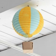 Check out how to make whimsical hot air balloon decorations for a nursery or party!