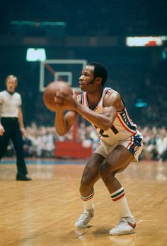 Lloyd Free of the Philadelphia 76ers looks to shoot against the Boston Celtics during an NBA basketball game circa 1976 at The Spectrum in...