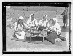 Day of celebration: four women sitting around a coffee table, village Negochani (Niki)