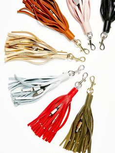 Leather Keychain iPhone Charger | American made statement fringe leather keychain that also doubles as an iPhone charger, with a USB and charging cord. Features a lobster clasp closure.