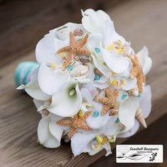 Beach wedding bouquet with orchids calla lilies roses sugar starfish and seashells with aqua pool blue color pins, sea shell bridal bouquet