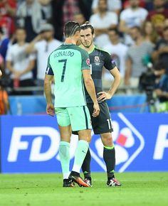 #EURO2016 Gareth Bale of Wales speaks with Cristiano Ronaldo of Portugal after the UEFA Euro 2016 semi final match between Portugal and Wales at Stade de Lyon...