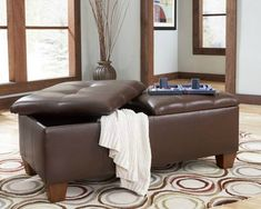 Use a storage ottoman for your coffee table and you kill three birds with one stone:  storage, seating and coffee table.  What a great option for a small apartment!