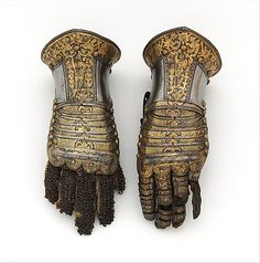 Pair of Gauntlets  Date: about 1585 Culture: Italian, Milan Medium: Steel, gold, silver, leather