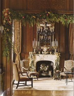 CHRISTMAS ELEGANCE Asmara Malmaison Neoclassical needlepoint rug, white fireplace, wood paneling, gold and grey damask fabric on French chairs, Christmas decorations.