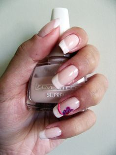 Classic french with an exotic flower and micro beads decorations. These are my own nails, no gel or acrylics used.