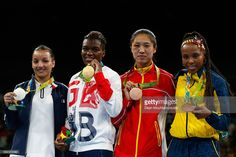 Silver medalist Sarah Ourahmoune of France, gold medalist Nicola Adams of Great Britain and bronze medalists Cancan Ren of China and Ingrit Valencia Victoria of Colombia pose during the medal ceremony for the Women's Fly (48-51kg) on Day 15 of the Rio 2016 Olympic Games at Riocentro - Pavilion 6 on August 20, 2016 in Rio de Janeiro, Brazil.