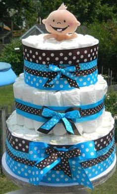 Mod Diaper Cake: This is the first diaper cake that I have ever made!! I think it's kinda cute!!