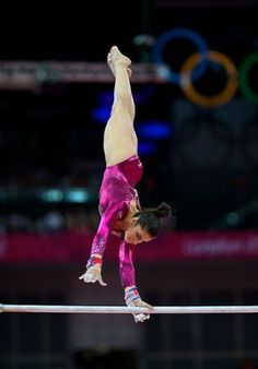 Team USA's Aly Raisman competes on the uneven parallel bars during the women's gymnastics all-around final at the London Olympics.