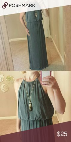 "Brand New Maxi Dress Sleek, comfortable and easy maxi dress. Ties at neck with opening in back(shown in last pic). Waist is stretchy. Lined so not see through. Beautiful charcoal color. Measures 42"" from waist. Top is very loose, billowy fit. (Necklace also for sale). H&M Dresses Maxi"