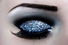 Glitter eyeshadow with false lashes and cut crease