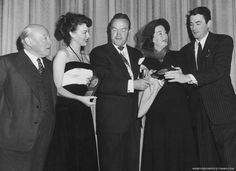 Edmund Gwenn, Ava Gardner, Rosalind Russell and Gregory Peck recive the Look Magazine Achievement Awards from Bob Hope, 1948