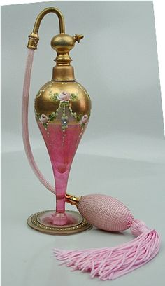 berengia:    Marcfranc France Perfume Atomizer Hand Painted 1800's This is a very unique hand painted Marfranc France perfume atomiser from the 1800's.