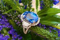 Stunningly gorgeous 8.52 carat sapphire with a half moon shaped diamond on each side surrounded by round diamonds set in white gold(1.24 carats total weight in diamonds!).