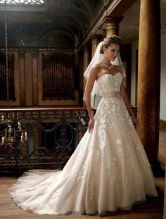 In love with the shape and color of this lace wedding dress by Mon Cheri.